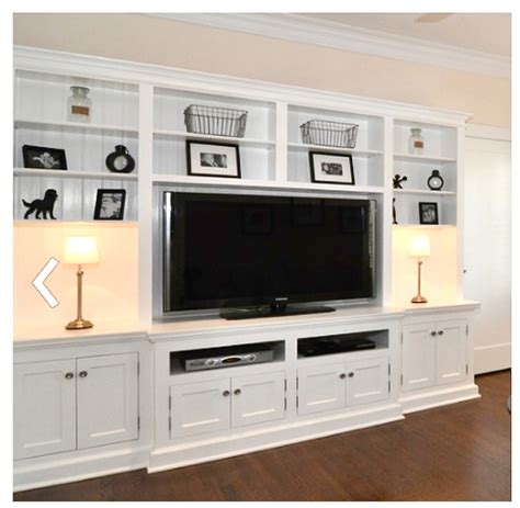 Tv In Bookcase by The Yellow Cape Cod Lake Front Living Room