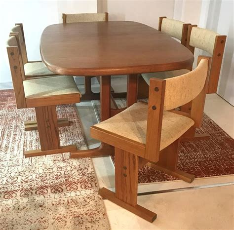 mid century teak extendable dining table and six