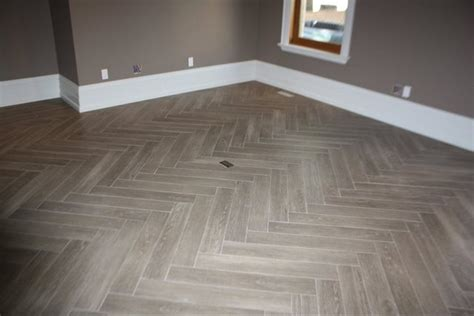 "Herringbone ""yes Its Tile"" Hardwood  Modern  Family Room"