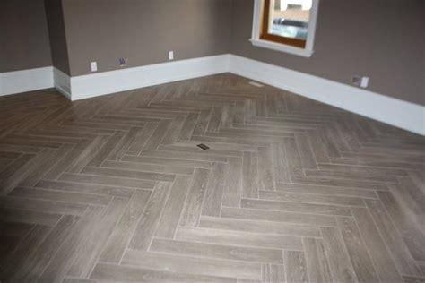"""Herringbone """"Yes its Tile"""" Hardwood   Modern   Family Room"""