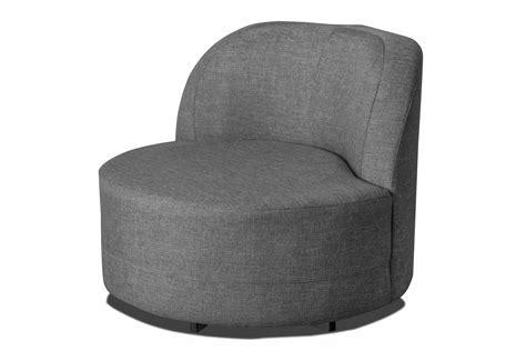 fauteuil pivotant design rond en tissu gris avec pouf