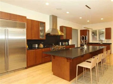 Black And Stainless Steel Appliances Mixed, Maple Kitchen