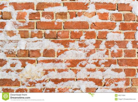 Brick Wall With Snow Perfect As Background Stock Photo