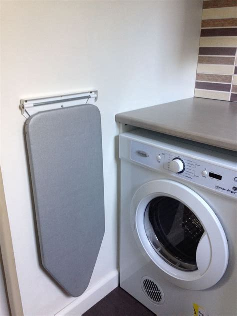 ironing board ideas   space  bright side laundry room storage laundry room