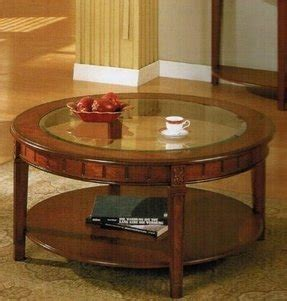 The tables in this series have no visible joints, featuring round glass tops placed on metal cylinders. Round Wood Coffee Table With Glass Top - Foter