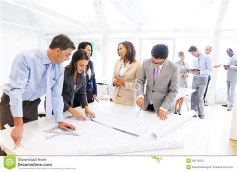 Group Of Architects Working On A New Project Stock Photo