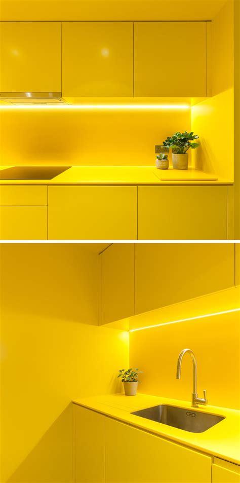 yellow kitchen brightens   north london basement
