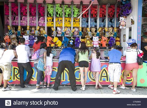 People Play One Of The Arcade Games At Coney Island Hoping