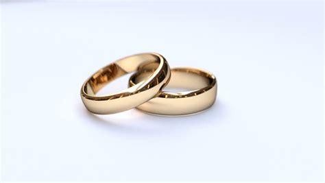 wedding ring stock photos studio shot of two wedding rings falling against white
