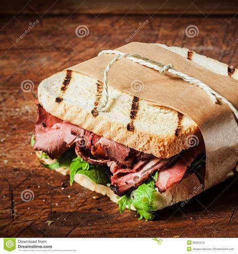 Grilled Roast Beef Sandwich In A Takeaway Wrapper Stock