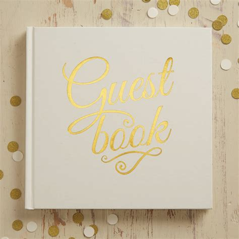 ivory  gold foiled wedding guest book  ginger ray