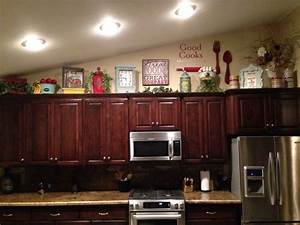 How to decorate on top of cabinets with vaulted ceiling for Kitchen cabinets lowes with the best wall art