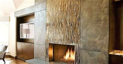 floor decor langhorne glass tile and metal panels combine to create an eye catching fireplace fixture fireplaces www