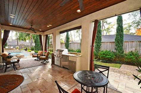 The Covered Patio And Outdoor Kitchen Are Adjacent To The