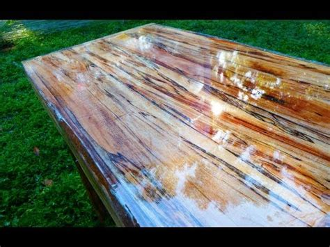 liquid glass for table top super high gloss table from tree limb repurposing