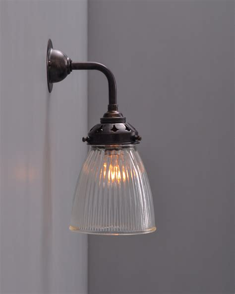 industrial wall light with prismatic glass shade