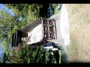 Dump truck dumping 12 tons of gravel - YouTube
