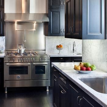 black countertops  white cabinets transitional kitchen bhg