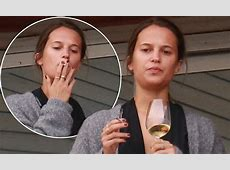 Alicia Vikander relaxes in Brazil with a glass of vino
