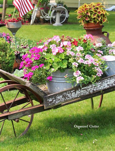 rustic garden wheelbarrow  organized clutter