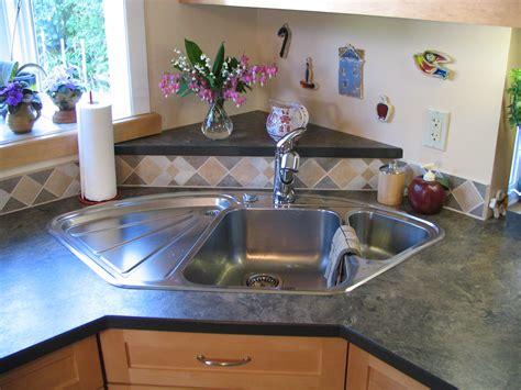 Corner Kitchen Sink Cabinet Ideas by Blanco Corner Sink With Raised Back Triangle Laminate