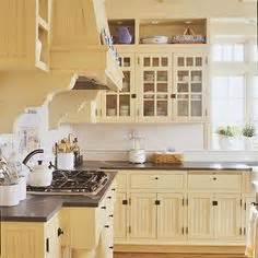 yellow painted kitchen cabinets baltic brown granite countertops light maple floors add 1697
