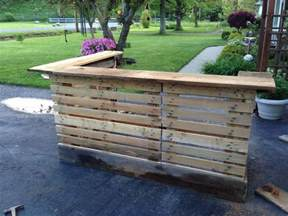 bar made from upcycled pallets and 200 year barn wood see other pics of finished bar