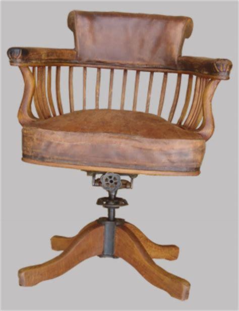 fauteuil de bureau ancien pivotant bois assise ety dossier cuir