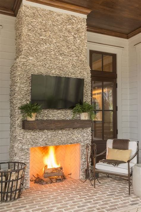 covered patio fireplace with flatscreen tv transitional