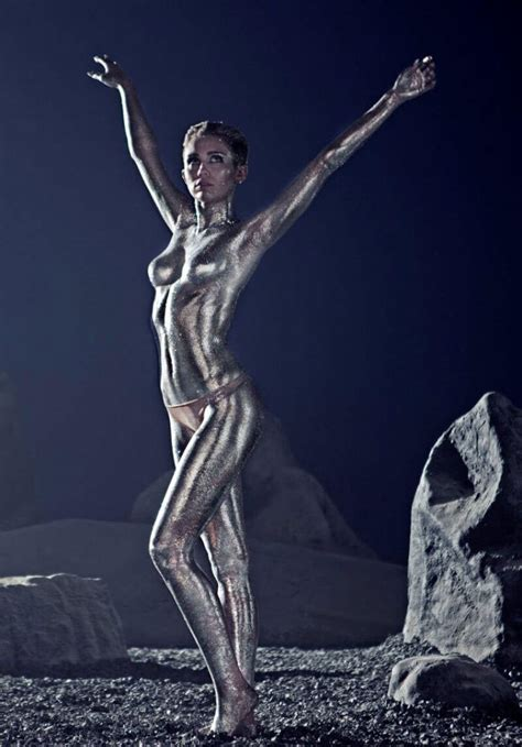 Miley Cyrus Stills Covered In Silver Body Paint Photos