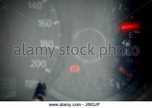 Gas meter showing black and red numbers on clear dial in a ...