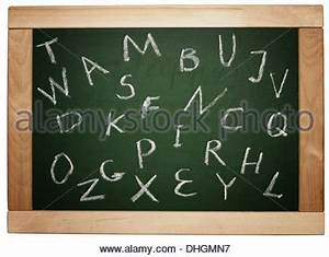 handwritten letters of the alphabet written on a With blackboard with white letters