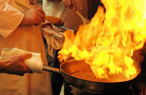 put  kitchen cooking oil pan fire fire news
