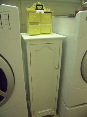 cabinet between washer and dryer thinkin of home estate finds