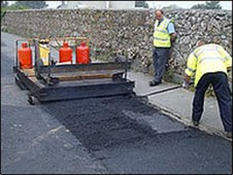 bbc news utility firm road repairs  devon