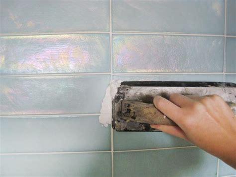 installing glass tiles for kitchen backsplashes kitchen update add a glass tile backsplash hgtv