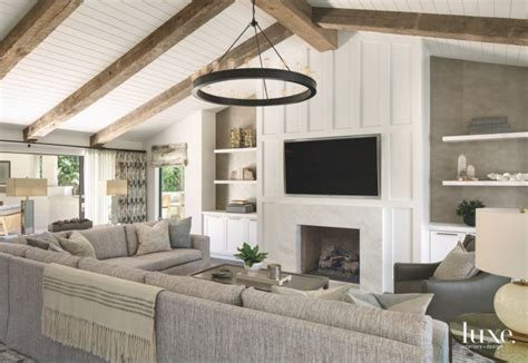 reclaimed wood vaulted ceiling living room  tv