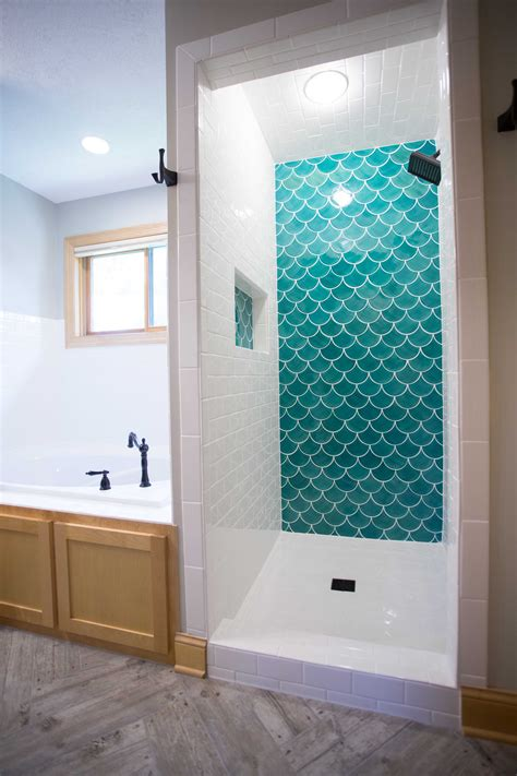 blue moroccan fish scale tile complimented by white subway