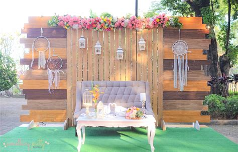 rustic setup wooden backdrop grass mat tufted couch