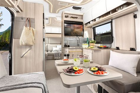 Enjoy a guided tour through the 2020 unity mb, featuring the optional patented leisure lounge plus, a 68 × 76 bed this is leisure travel van 2020 full view tour unity murphy bed interior & exterior mercedes benz sprinter rv tour leisure unity. Unity Rear Lounge in 2020   Leisure travel vans, Travel, leisure, Lounge