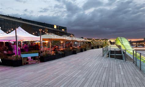 cite de cuisine nüba restaurant et perchés sur le toit des docks