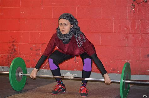 Muslim Woman Prevails in Changing Weightlifting Dress Code