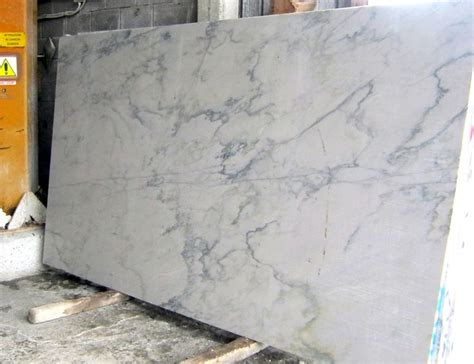 white quartz island that looks like marble white granite