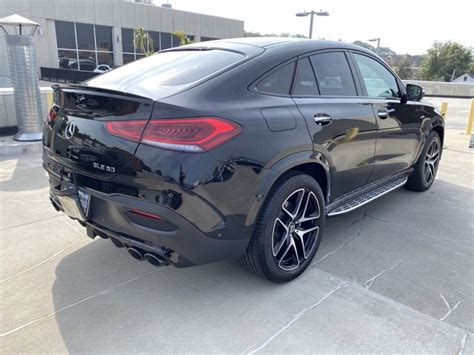 Two giant digital displays dominate the dashboard, are the gle's cabin is spacious, even in the back seat; New 2021 Mercedes-Benz AMG GLE 53 4MATIC Coupe SUV | Black 21-2