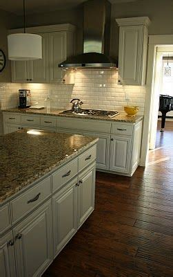 antique white cabinets brown granite hardwood floors