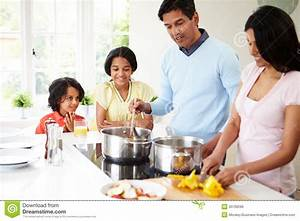Indian Family Cooking Meal At Home Stock Photo - Image ...