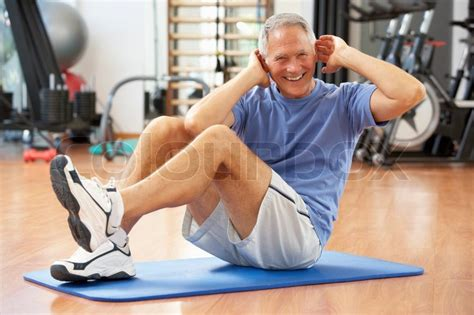 senior doing sit ups in stock photo colourbox