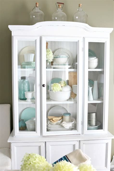 how to decorate a china cabinet vintage style decorating with demijohns bhg style spotters