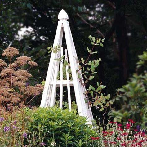 images  wooden garden obelisks  pinterest gardens raised beds  topiary garden