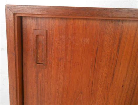 mid century cabinet doors mid century modern teak sliding door cabinet at 1stdibs